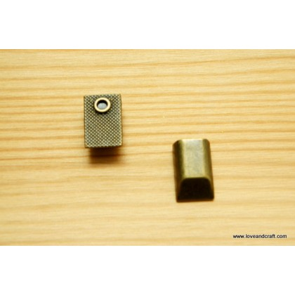 *T00228(10/3)-* Metal zip end clip